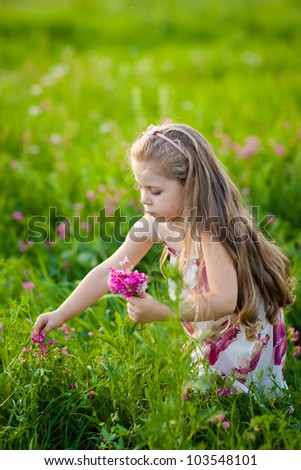Cute child with bouquet of field flowers - stock photo