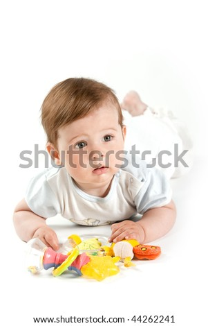 Cute child with toys. Boy. Studio shot