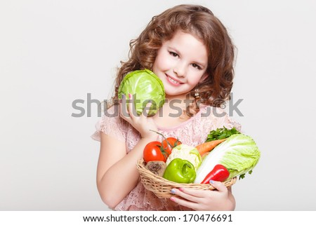 Cute Child with vegetables, Gardening. Lovely little girl with basket of ecological harvests, Kid with healthy food. studio, isolated on white background.  - stock photo