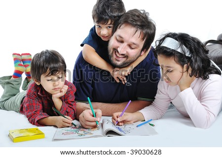 Cute children are painting and playing with their father