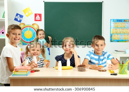 Cute children at lunch time in classroom