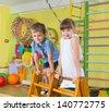 Cute children playing in kindergarten gym - stock photo