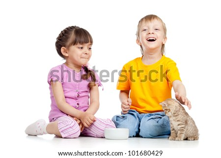 Cute children playing with kittens. Isolated on white background - stock photo