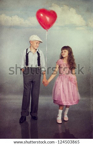 Cute children walk with a red balloon. Photo in retro style with old textured paper. - stock photo