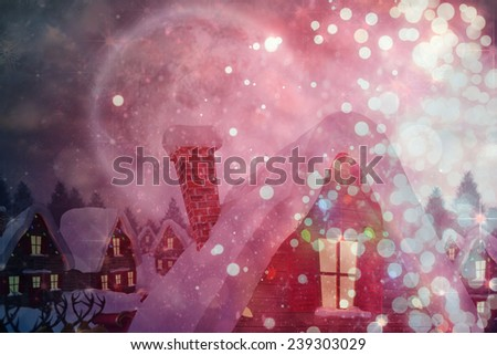 Cute christmas village under full moon against light design shimmering on red - stock photo