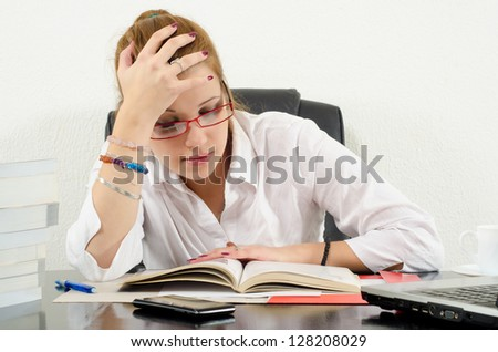 Cute chubby girl studying for exams. - stock photo
