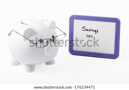 Cute concept of a piggy bank ready to teach how to save some money in life and business - stock photo