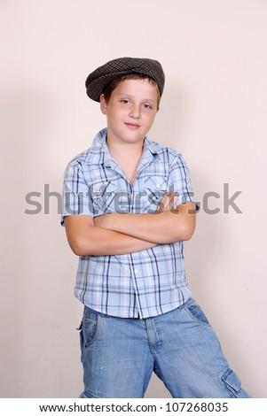Cute cool boy in cap - stock photo