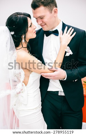 cute couple, bride and groom - stock photo