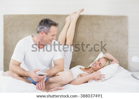 Cute couple cuddling in bed in their room
