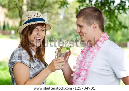 Cute couple drinking mojito coctail - stock photo