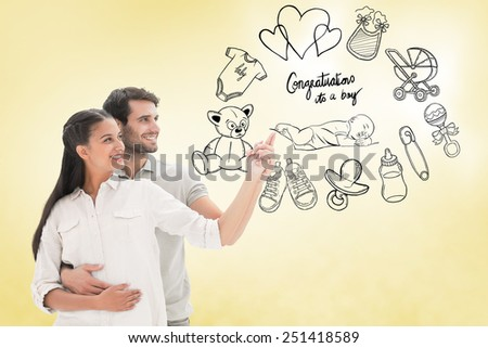Cute couple embracing and pointing against yellow vignette - stock photo