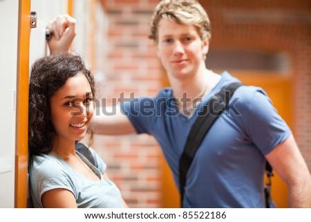 Cute couple flirting in a corridor - stock photo
