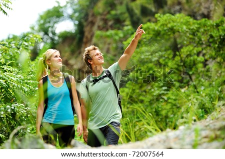 cute couple have fun together outdoors on a hike
