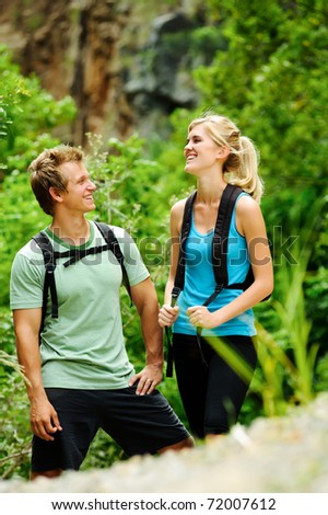 cute couple have fun together outdoors on a hike - stock photo