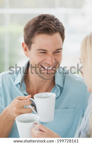 Cute couple having coffee together in cafe on a sunny day in the city - stock photo
