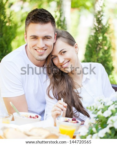 Cute couple in love having breakfast together.
