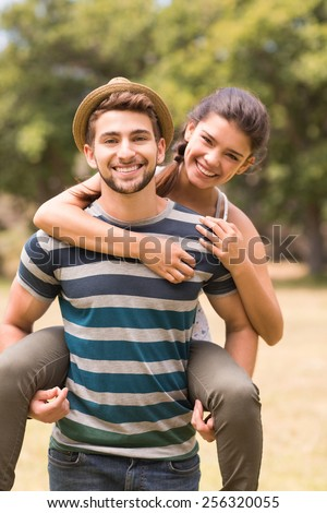 Cute couple in the park on a sunny day - stock photo