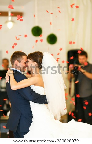 cute couple is hugging on the  background restaurant - stock photo
