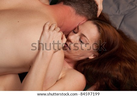 Cute couple laying down together, in passion and romance