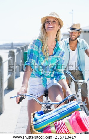 Cute couple on a bike ride on a sunny day - stock photo