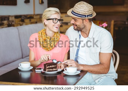 http://thumb7.shutterstock.com/display_pic_with_logo/76219/292949525/stock-photo-cute-couple-on-a-date-eating-a-piece-of-chocolate-cake-at-the-cafe-292949525.jpg