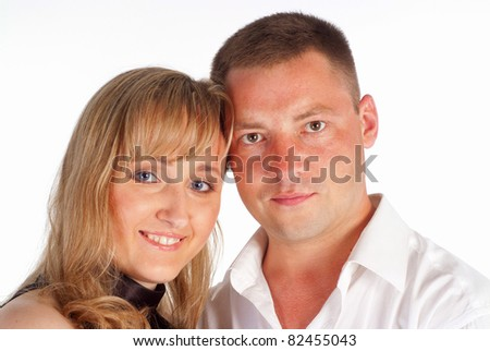 cute couple posing on a white background
