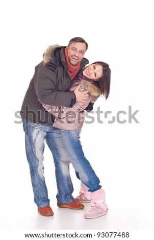 cute couple posing on white in outerwear