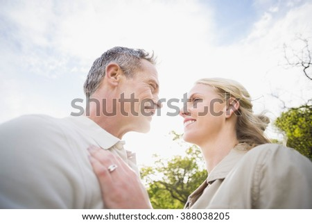 Cute couple smiling at each other outside