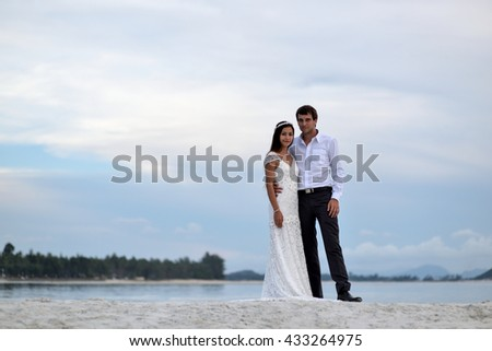 Cute couple wedding ceremony on the beach.
