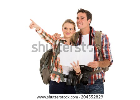 cute couple with backpacks and map on white background - stock photo
