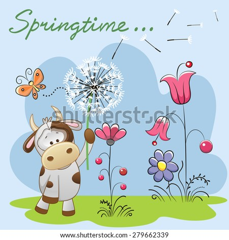 Cute Cow with dandelion on a meadow  - stock photo