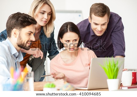 Cute creative team is discussing a new project - stock photo