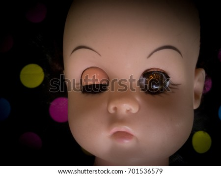 cute creepy doll on  dot background