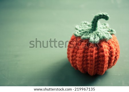 Cute Crocheted Mini Pumpkin, Halloween crochet for home decorating - stock photo