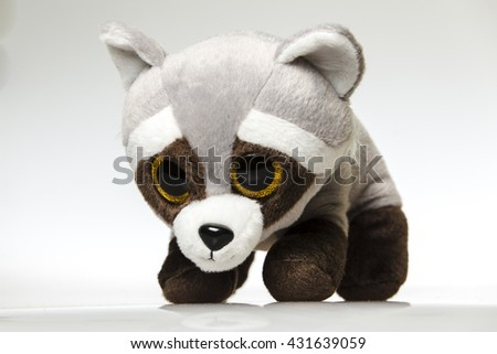 Cute cuddly raccoon toy. Raccoon - small plush toy animal - stock photo