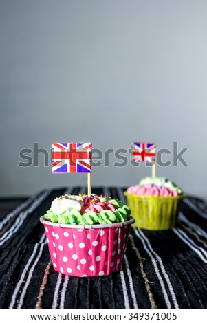 Cute cupcakes with British flag on top.
