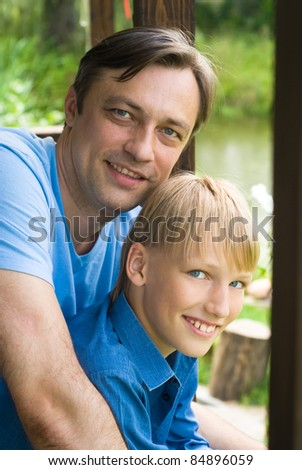 cute dad with his son posing outdoors