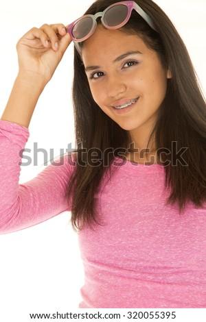 Cute dark complected girl portrait raising glasses - stock photo