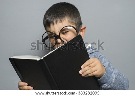 cute dark-haired young student reading a funny book, reading and learning