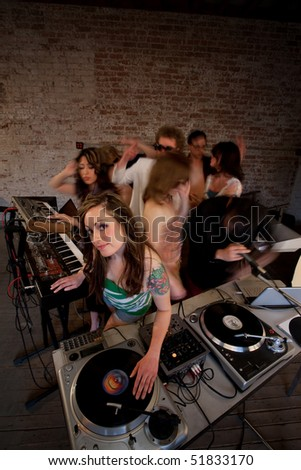 Cute DJ at 1970s Disco Music Party - stock photo
