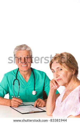 cute doctor sitting with patient at table