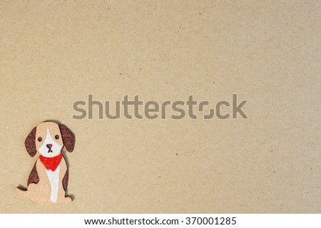 Cute Dog with red scarf isolated on a recycle kraft board cover, for wallpaper, background (Dog Breed is probably Beagle) Write your text in the middle - stock photo