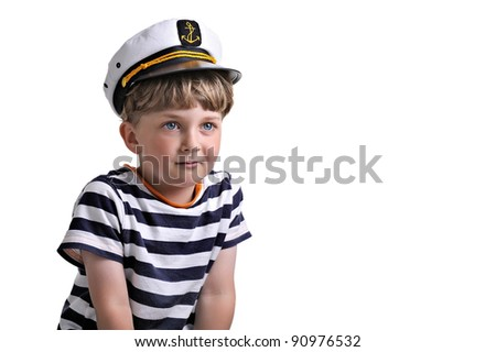 Cute dreaming child in captain cap. isolated over white background.