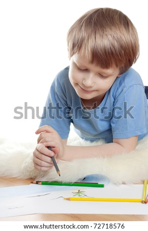 Cute dreaming child lies and draw on soft sheep fur isolated over white background. High key.