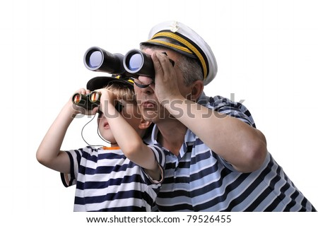 Cute dreaming child with his father. both in captain cap looking through a binocular. isolated over white background.