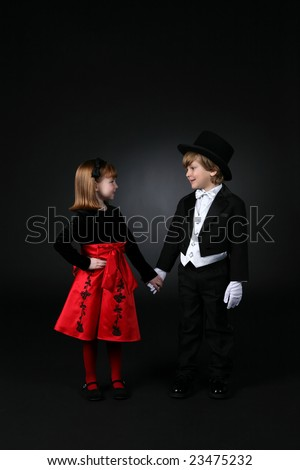 cute dressed up children holding hands