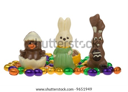 cute easter bunnies and chick surrounded by chocolate easter eggs isolated on a white background - stock photo