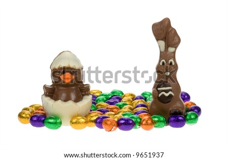 cute easter bunny and chick surrounded by chocolate easter eggs isolated on a white background - stock photo