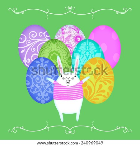 Cute Easter Bunny proudly standing before rows of decorated eggs - stock photo